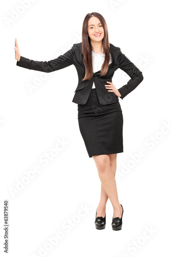 Businesswoman leaning against a wall
