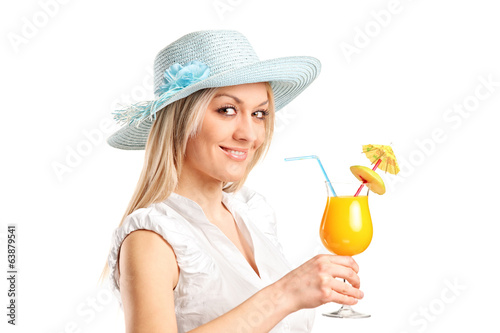 Blond woman holding an exotic cocktail