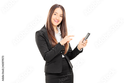 Businesswoman pointing towards a cell phone