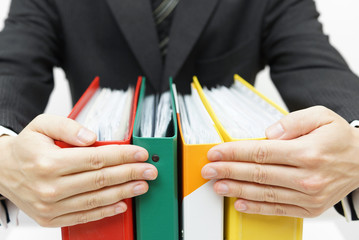 businessman holding binders at office