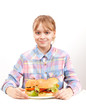 Little smiling blond girl with big homemade hamburgers on white