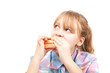 Little blond girl eats burger. Photo Isolated on white backgroun