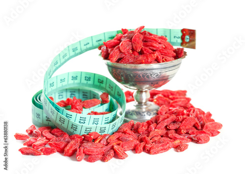 goji berries with a measuring meter isolated on white background