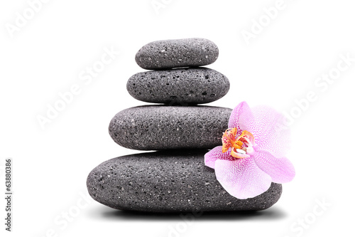 Stack of balanced stones and an orchid