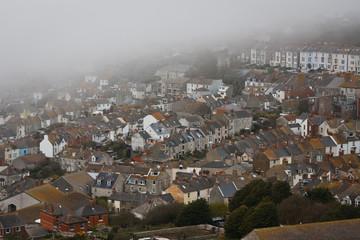 Portland houses in fog, Dorset.