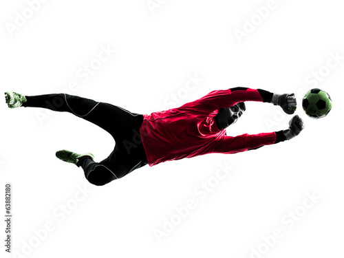 caucasian soccer player goalkeeper man punching ball silhouette
