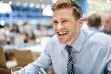 Smiling corporate man at restaurant