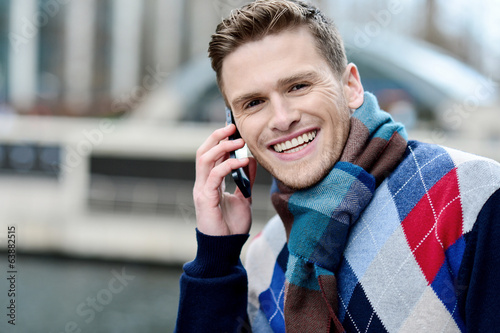 Handsome man using his mobile at outdoors