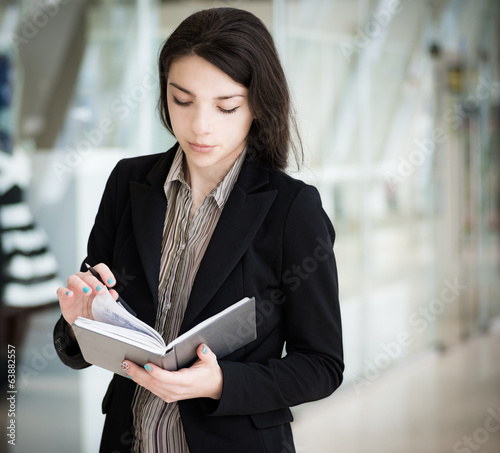 Young girl with pen and notebook.
