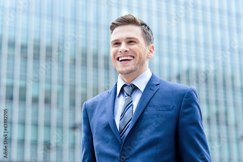 Young businessman posing at outdoors
