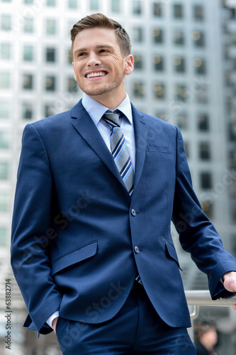 Handsome businessman posing at outdoors