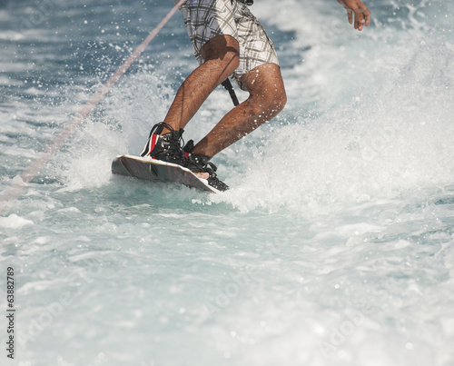 Closeup of wakeboarder on water