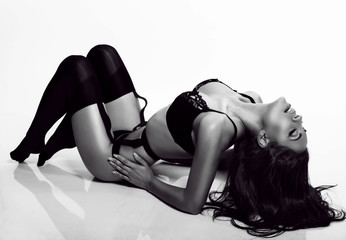 sexy body of woman with dark hair in black lingerie