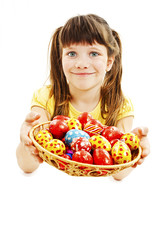A pretty girl happy with her Easter eggs on white background