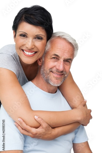 Portrait of a happy woman embracing man from behind
