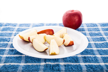 Red Apple with Slices on White Plate