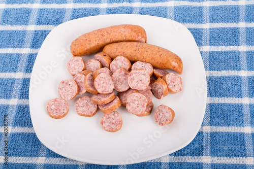 While and Sliced Sausage on a Plate