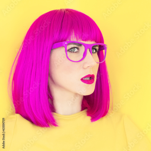 Portrait of a stylish girl on a bright background