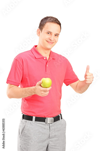 Man holding an apple and giving thumb up
