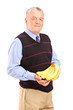 Mature man holding bananas