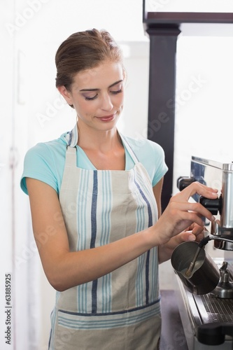 Female barista preparing espresso at coffee shop