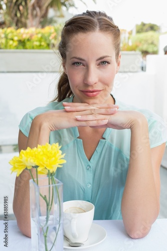 Portrait of a beautiful woman drinking at café