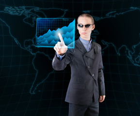 Futuristic businessman analyzing economic data