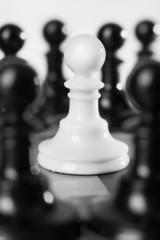 Single little pawn among many enemies