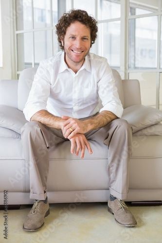 Portrait of a well dressed young man at home