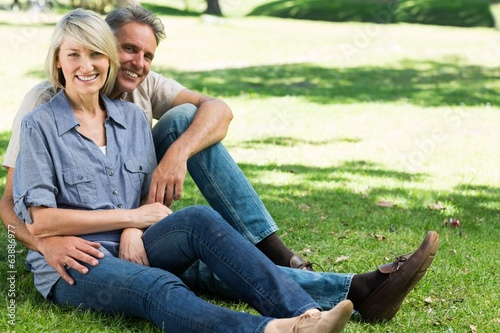 Happy couple sitting in park