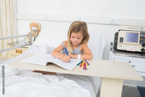 Sick girl coloring book in hospital