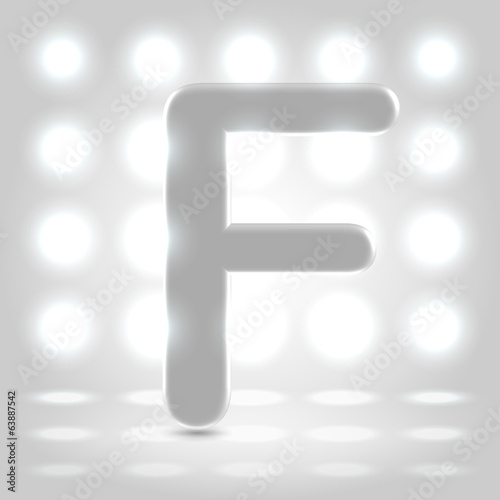 F over lighted background