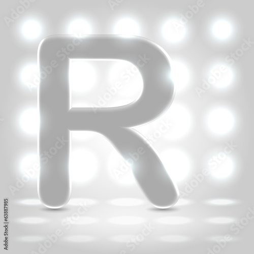 R over lighted background