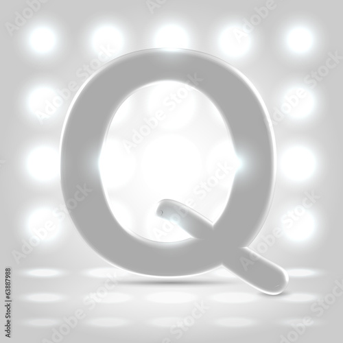 Q over lighted background