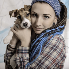 beautiful girl with dreadlocks and dog puppy Jack Russell terrie