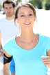 Fitness girl running in the street