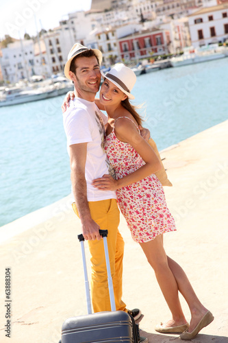 Cheerful couple getting of the boat in Balearic island