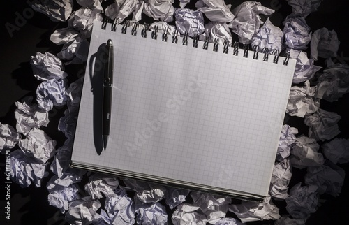 Graph paper notebook with pen