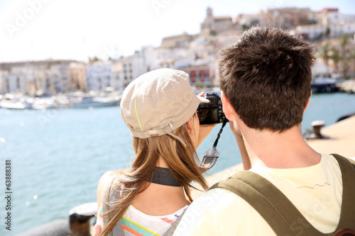 Couple taking picture of panoramic city view
