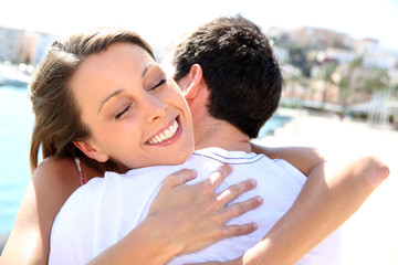 Couple hugging and being happy to get together