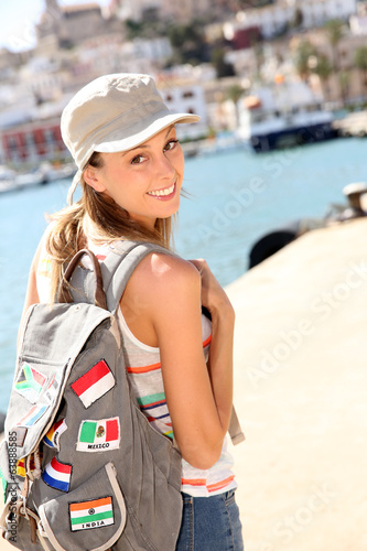 Cheerful girl visiting Ibiza Island