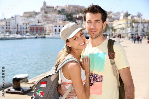 Cheerful couple of tourists visiting Ibiza