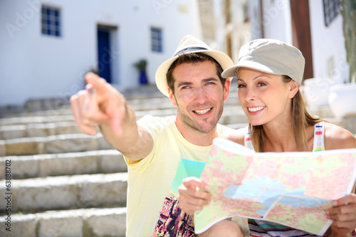 Tourists enjoying typical architecture of Ibiza island