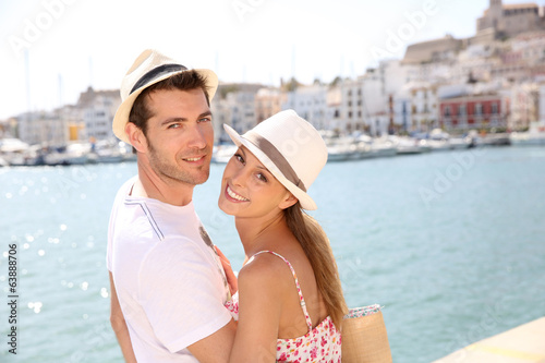 Portrait of cheerful couple traveling to balearic island