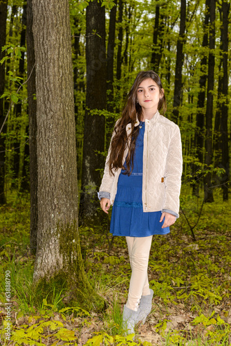 portrait of a girl in the spring forest
