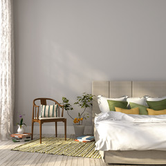 Beige bed with green decor