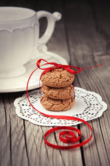 Cup of tea and cookies on wooden background