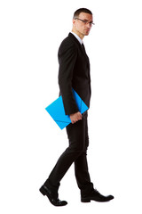 businessman in glasses with blue folder