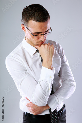Portrait of a thoughtful businessman in glasses