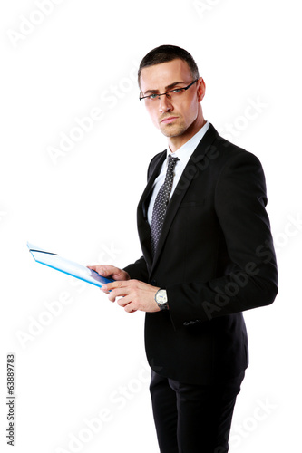 Portrait of a confident businessman holding folder